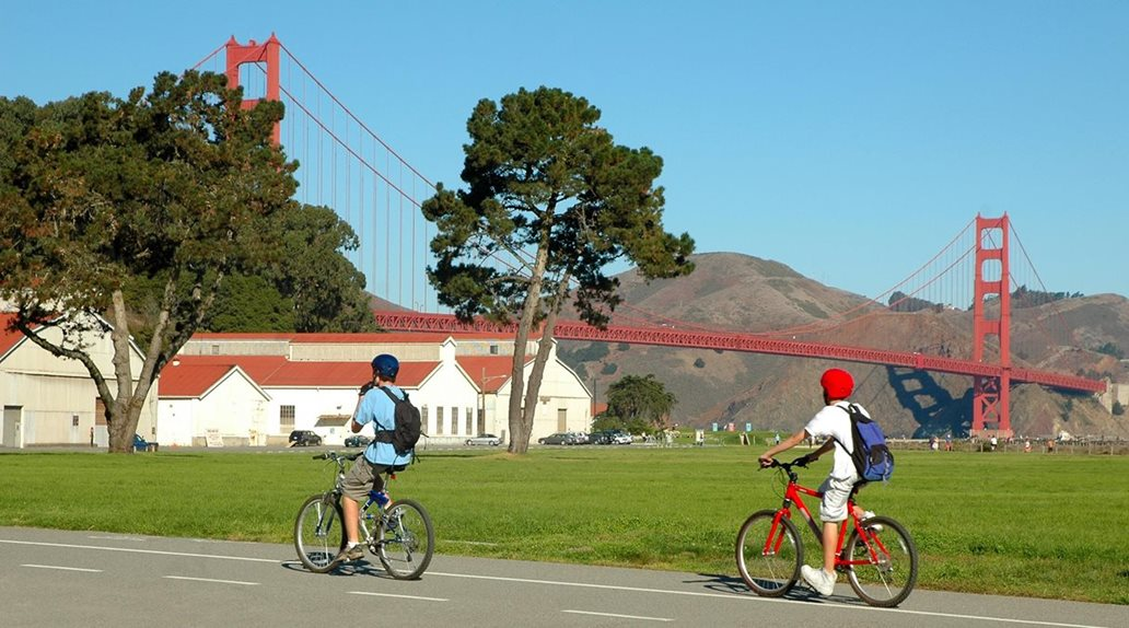Kids bike riding by Golden Gate Bridge